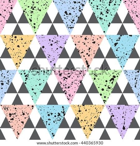 Colorful triangles with black splash or blobs texture seamless vector pattern. Geometric multicolor abstract background. Triangles with uneven spots, specks, blots texture. - stock vector
