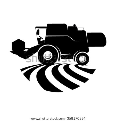 Combine harvester in a field - stock vector