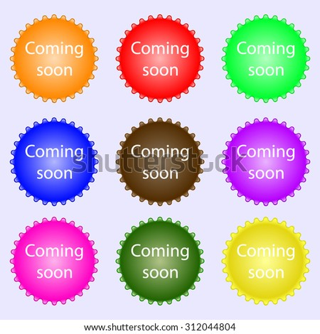 Coming soon sign icon. Promotion announcement symbol. A set of nine different colored labels. Vector illustration