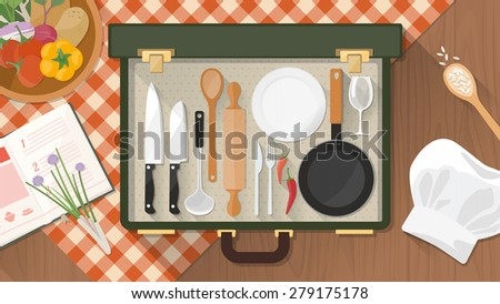 Cooking and kitchen utensils in an open vintage suitcase on a checked tablecloth with chef's hat, cookbook and fresh vegetables - stock vector