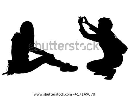 Couples with a camera on white background