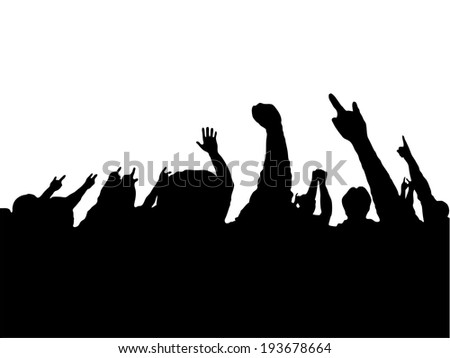 crowd of people with hands up on concert