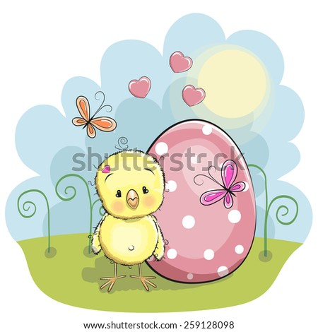 Cute chicken with egg on the meadow