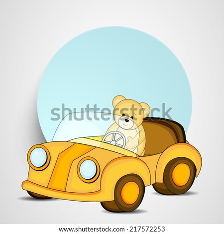 Cute little teddy year driving toy car with blank sticky on grey background.