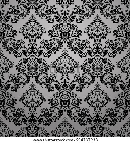 Damask seamless floral pattern. Royal wallpaper. Flowers on a black background. Luxurious vector ornament. Stylish graphic pattern