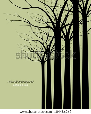 dark trees without leaves on green background