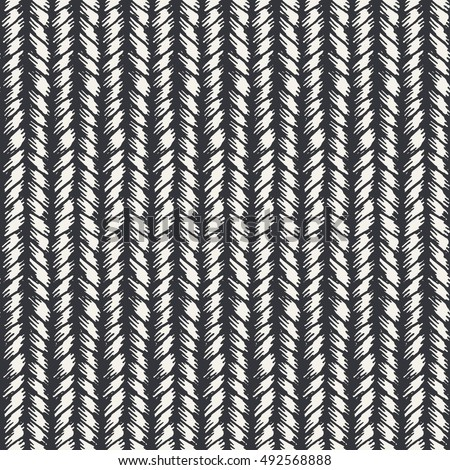 Decorative knit seamless pattern. Hand drawn endless gray knitting ornament. Trendy messy knitwork texture. Vector design for cloth, backdrops, apparel, wrapping, wallpaper