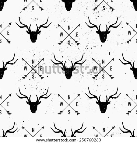 Deer head and arrows seamless pattern in black and white. - stock vector