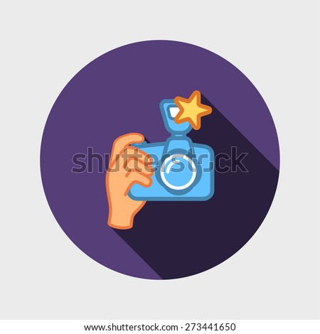 digital photo camera in hand - stock vector