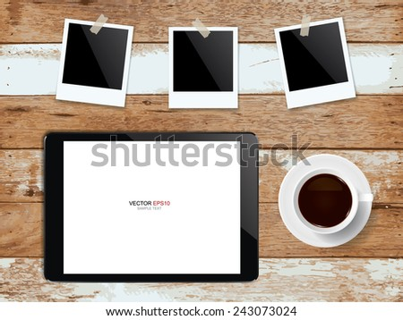 Digital tablet with coffee cup and blank photo frame on vintage wooden texture. Vector illustration.