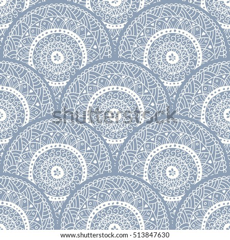 Doodle circles seamless pattern in blue and beige. Endless pattern can be used for ceramic tile, wallpaper, linoleum, textile, invitation card, wrapping paper,web page background.