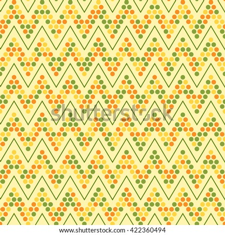 Dotted zigzag seamless pattern. Geometric abstract background in yellow, orange and green colors. Stylish mosaic texture. Good for design of wrapping paper, invitation and greeting cards.