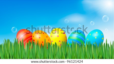 Easter background. Easter eggs laying in green grass under blue sky. Vector. - stock vector