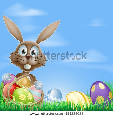 Easter bunny rabbit in a field with a basket of chocolate Easter eggs with copyspace in the sky
