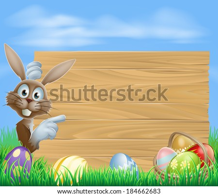 Easter bunny rabbit pointing at a sign with a basket of chocolate Easter eggs