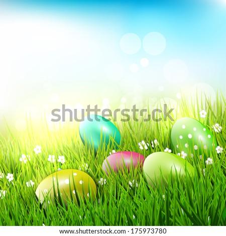 Easter eggs in the grass - Easter illustration   - stock vector