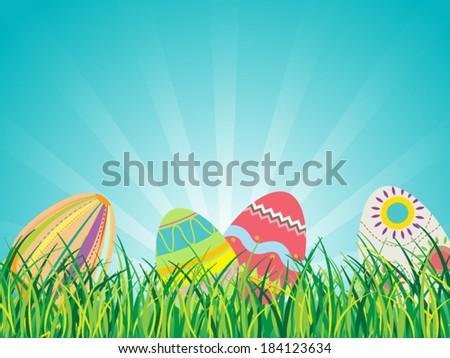 Easter Eggs on Grass with Blue Sky Background