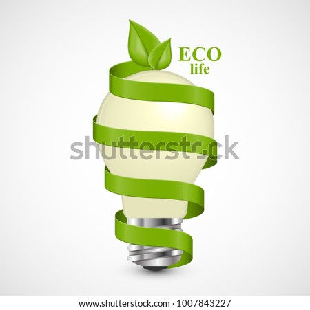 Eco energy concept. Light bulb wrapped with green ribbon and green leaves at the top.