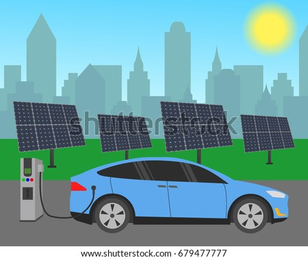 Electric car charging at the charger station in front of the solar panels. City skyline in the background. Electromobility e-motion concept.