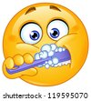 Emoticon brushing his teeth - stock photo