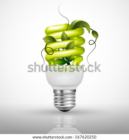 Energy saving concept with lightbulb green leaves and grass - stock vector