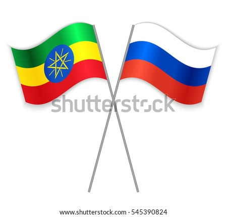 Ethiopian and Russian crossed flags. Ethiopia combined with Russia isolated on white. Language learning, international business or travel concept.