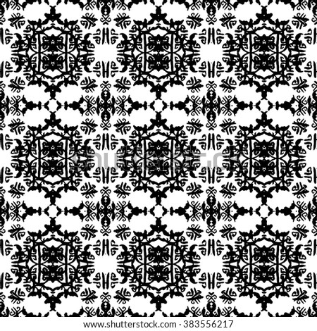 Ethnic Aztec pattern. Striped hand painted aztec vector seamless pattern with ethnic and tribal motifs, zigzag lines, brushstrokes and splatters of paint black and white colors Vector illustration.