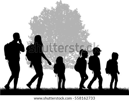 Family Reaching With Backpacks On A Trip