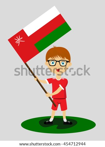Fan of Oman national football team, sports. Boy with flag in the colors of the state command with sports paraphernalia.