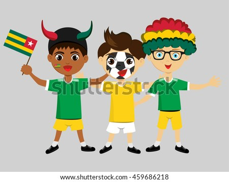 Fan of Togo national football team, sports. Boy with flag in the colors of the state command with sports paraphernalia.