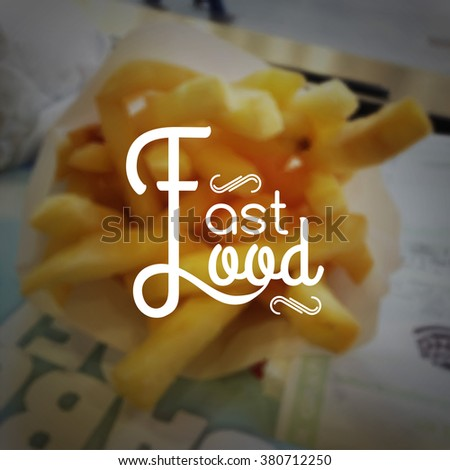 Fast food logo typography lettering on blurred French fries background.