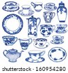 Fine China - Set of hand drawn porcelain teacups and saucers, teapots, plates, creamers etc, in cobalt blue Toile de Jouy pattern   - stock photo