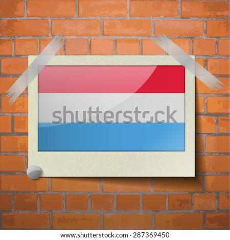 Flags of Luxembourg scotch taped to a red brick wall. Vector - stock vector