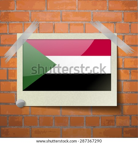Flags of Sudan scotch taped to a red brick wall. Vector - stock vector