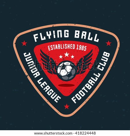 Flying Ball Varsity, College, School, Amateur League Football Soccer Sport Team Logo Concept, T Shirt Graphics. Jersey Apparel Design. Retro Old-Fashioned Distressed Textured Vector Illustration.  - stock vector