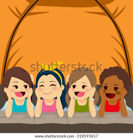 Four little cute girls friends camping inside tent at night
