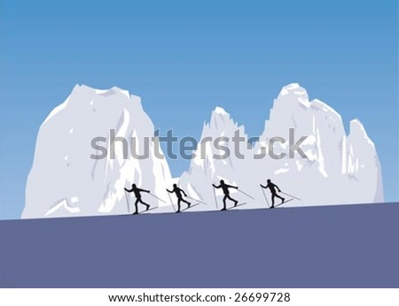 Four nordic skiers skiing in snowy mountains