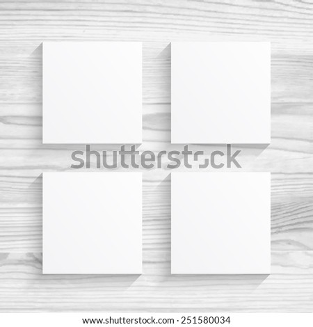 Four square blanks sheet of paper on white wood texture background - stock vector