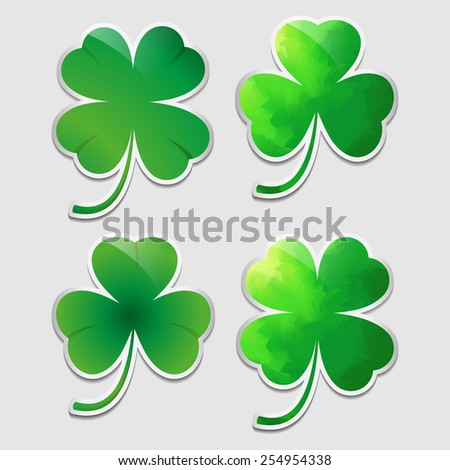 Four stickers with different clover leaves - stock vector