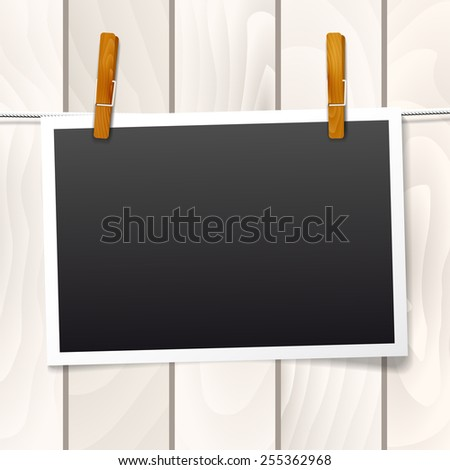 Frame for your text or photo hanging on a rope on wooden background - vector illustration - stock vector