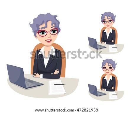friendly female CEO wearing glasses sitting at her desk in the office