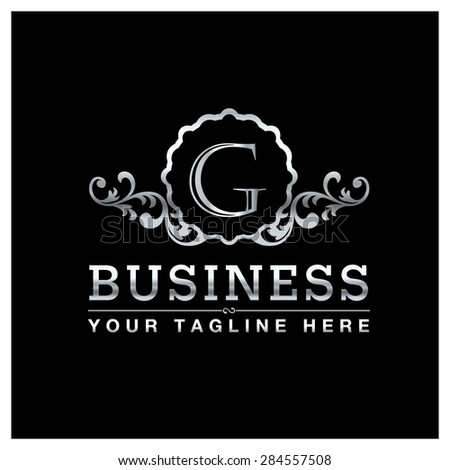 G letter Silver Luxury Logo template flourishes calligraphic elegant ornament lines. Business sign, identity for Restaurant, Royalty, Hotel, Heraldic, Jewelry, Fashion and other vector illustration