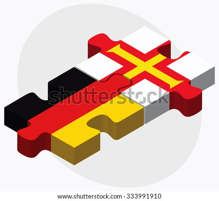Germany and Guernsey Flags in puzzle isolated on white background