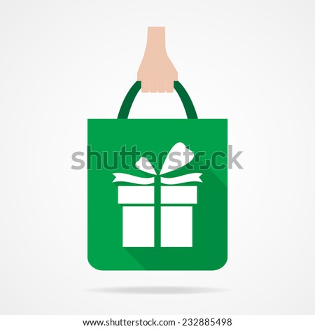 Gift box on green shopping bag icon.  Flat design.Vector EPS 10 - stock vector