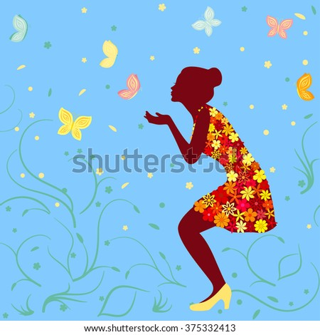 Girl in bright floral dress and butterflies