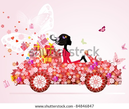 girl on a red car with floral gifts