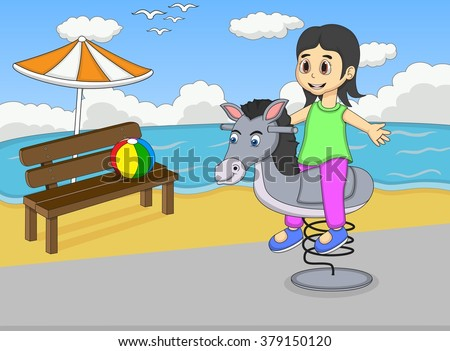 Girl playing rocking horse at the beach