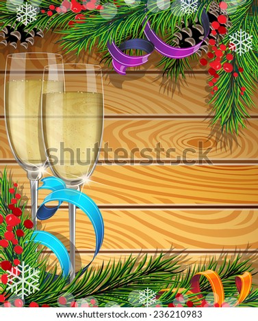 Glasses of champagne, Christmas ribbons and fir tree branches on wooden background
