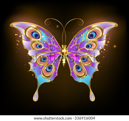 gold butterfly with wings patterned peacock on a dark background.
