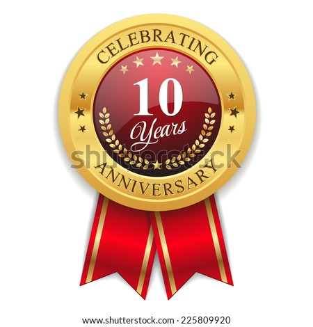 Gold 10 years anniversary badge with red ribbon on white background